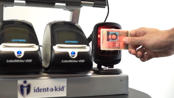 Visitor scanning their license with Ident-A-Kid Visitor Management.