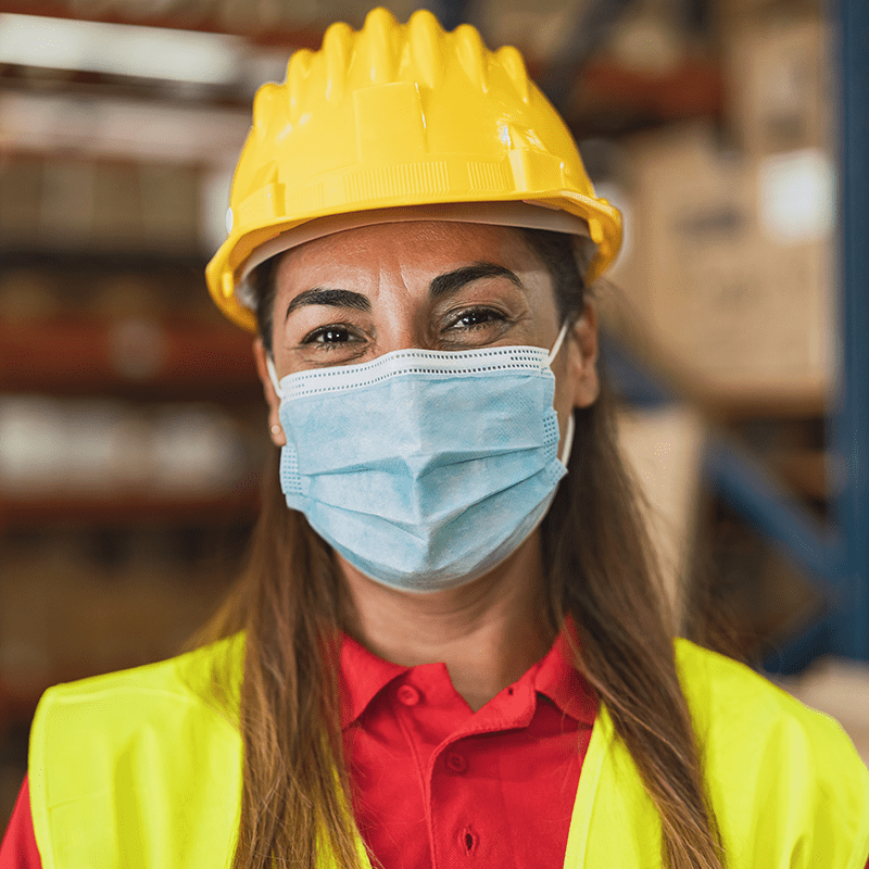 Happy worker wearing a mask to help prevent the spread of COVID.